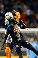 Keon Daniel (26) of the Philadelphia Union goes up for a header with Ricardo Clark (13) of the Houston Dynamo. The Houston Dynamo defeated the Philadelphia Union 1-0 during a Major League Soccer (MLS) match at PPL Park in Chester, PA, on September 14, 2013.