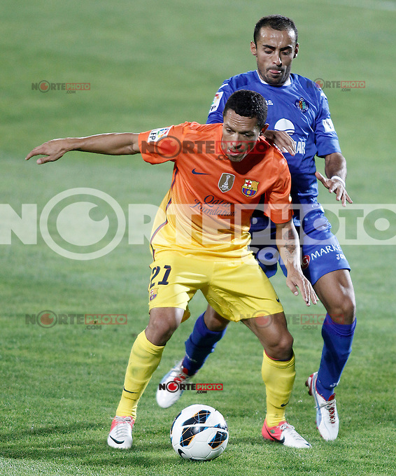 Getafe's Diego Castro (r) and FC Barcelona's Adriano Correia during La Liga match.September 15,2012. (ALTERPHOTOS/Acero) /NortePhoto<br />