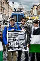 Roma 2 Dicembre 2013<br /> Manifestazione del &quot;Coordinamento Netanyahu  non gradito&quot;, per protestare contro la visita in Italia del Primo ministro israeliano  Benjamin Netanyahu, durante l'incontro con Papa Francesco  e contro l'applicazione del Piano Prawer-Begin<br /> Rome December 2, 2013<br /> Demostration of the  &quot;Netanyahu  not welcome committee&quot; to protest against the visit to Italy, the Israeli Prime Minister Benjamin Netanyahu  during his meeting with Pope Francis,  and against the implementation of the Prawer-Begin Plan