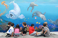 Children help paint David Legaspi's Ocean-Themed mural at Franklin Elementary School on Saturday, September 3, 2011. This mural is just part of a bigger and more significant courtyard remodeling project in the school featuring new tables, awnings and landscaping. The Courtyard remodeling project was sponsored by the Grazer family.