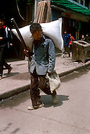 April 15th, 1989, Poyang, Jiangxi Province, China: daily life, carrier people.