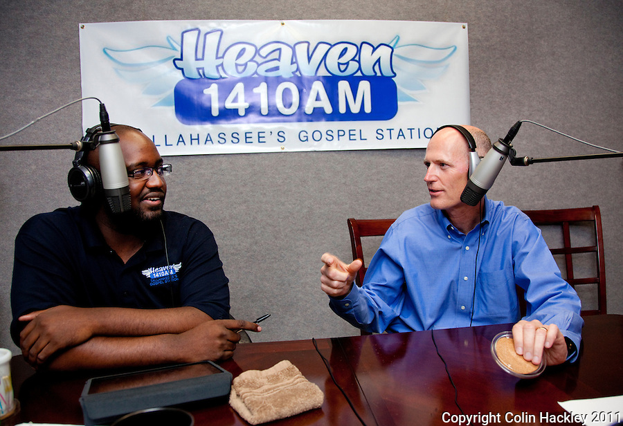 TALLAHASSEE, FLA. 7/28/11-SCOTTRADIO HACKLEY06-Gov. Rick Scott, right, responds to questions from radio talk show host Jay Green during Green's show on gospel radio station WHBT 1410 AM, Thursday in Tallahassee. Recently Scott has been appearing on talk radio across the state several times a day as a way to get his message out to Floridians..COLIN HACKLEY PHOTO