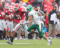 The Georgia Bulldogs played North Texas Mean Green at Sanford Stadium.  After North Texas tied the game at 21 early in the second half, the Georgia Bulldogs went on to score 24 unanswered points to win 45-21.  Georgia Bulldogs wide receiver Reggie Davis (81), North Texas Mean Green defensive back Kenny Buyers (31)