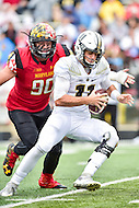 College Park, MD - OCT 1, 2016: Maryland Terrapins defensive lineman Roman Braglio (90) breaks though and sacks Purdue Boilermakers quarterback David Blough (11) during game between Maryland and Purdue at Capital One Field at Maryland Stadium in College Park, MD. The Terps got the win 50-7 over visiting Purdue. (Photo by Phil Peters/Media Images International)