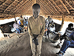 The pastor leads prayers during Sunday morning worship at the United Methodist Church in Pisak, a small village in Central Equatoria State in Southern Sudan. NOTE: In July 2011, Southern Sudan became the independent country of South Sudan
