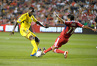Chicago midfielder Pavel Pardo (17) lunges to knock the ball away from Columbus midfielder Tony Tchani (6).  The Chicago Fire defeated the Columbus Crew 2-1 at Toyota Park in Bridgeview, IL on June 23, 2012.