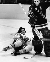 Seals Dave Hrechkosy after scoring goal against the New York Rangers goalie Ed Giacomin. 1974 (photo/Ron Riesterer)