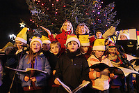 """NO REPRO FEE. 17/12/2010. Focus Ireland festive lights. Pamela Flood , Joyce Loughnan, CEO Focus Ireland and children from the Piccolo Lasso Choir switched on the lights on the Christmas Tree at Grafton St. this evening (Fri Dec 17th) for the Focus Ireland """"Sponsor a Star"""" campaign. EUR250,000 has been raised by businesses sponsoring a star on the landmark tree which is dedicated to people who are homeless. Picture James Horan/Collins Photos"""