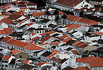 Beautiful Angra do Heroismo features whitewashed houses with orange colored roofs on Terceira, Azores. Angra, badly damaged by an earthquake in 1980, is one of the finest examples of Renaissance architecture and is the only entire town was put on the heritage lists by the United Nations Educational, Scientific and Cultural Organization. (Jim Bryant Photo).....