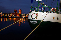 (Oslo, Norway. Dec 9, 2009) Greenpeace ship Rainbow Warrior in Oslo. Docked near Oslo Town Hall (background), where US president Barack Obama will receive Nobel Peace Prize on Dec 10 2009.