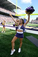 2013-09-21: Washington cheerleader Jessica Saunders entertained fans during the game  against Idaho State.  Washington won 56-0 over Idaho State in Seattle, WA.
