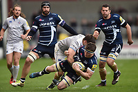 Tom Curry of Sale Sharks is tackled to ground. Aviva Premiership match, between Sale Sharks and Bath Rugby on May 6, 2017 at the AJ Bell Stadium in Manchester, England. Photo by: Patrick Khachfe / Onside Images