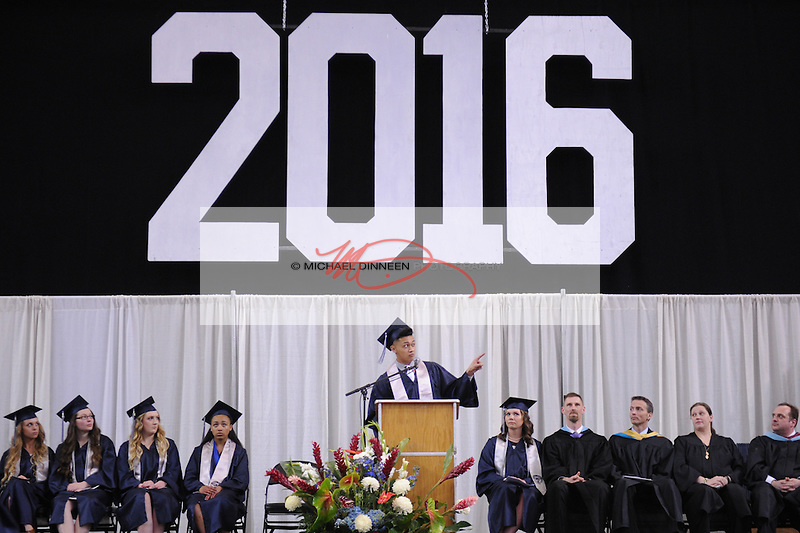Class speaker Vave' Graf gestures towards his parents during his speech at the Eagle River High School commencement Monday May 9, 2016.  Photo for the Star by Michael DInneen