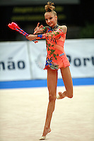 Maryia Yushkevich of Belarus expresses dance with clubs during event finals for juniors at 2006 Portimao World Cup of Rhythmic Gymnastics on September 10, 2006.  (Photo by Tom Theobald)