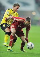FUSSBALL   1. BUNDESLIGA  SAISON 2011/2012   13. Spieltag  19.11.2011 FC Bayern Muenchen - Borussia Dortmund         Franck Ribery (re, FC Bayern Muenchen) gegen Mario Goetze (Borussia Dortmund)