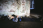 A Confederate defender sleeps after  attacking Union forces during the Battle of Fort Morgan, Mobile, Al in 2001.  Ft. Morgan, a critical fortification during the Civil War, was the next-to last fortress to fall as the Civil War ended. Jim Bryant Photo. @2001. All Rights Reserved.
