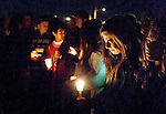 A Bennion Junior High student cries during a moment of silence for a Bennion student who committed suicide earlier in the day. The candlelight vigil at the school in his memory drew hundreds of students, families and friends, Thursday, Nov. 29, 2012.