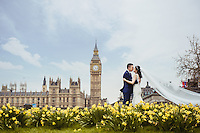 A Chinese couple pose for their wedding photos in London close to the Houses of Parliament and Big Ben, UK. . An increasing number of Chinese couple are having their wedding photos taken in the English country-side, classic towns and monuments to show in China. <br /> <br /> Photo by Sinopix