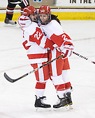 Jill Cardella (BU - 22),Britt Hergesheimer (BU - 2) - The Northeastern University Huskies tied Boston University Terriers 3-3 in the 2011 Beanpot consolation game on Tuesday, February 15, 2011, at Conte Forum in Chestnut Hill, Massachusetts.