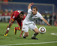 Ghana's (23) Kevin Prince Boateng and the USA' s (6) Steve Cherundolo chase a loose ball  in the first half of the 2010 second round World Cup match between USA and Ghana in Rustenberg, South Africa on Saturday, June 26, 2010.