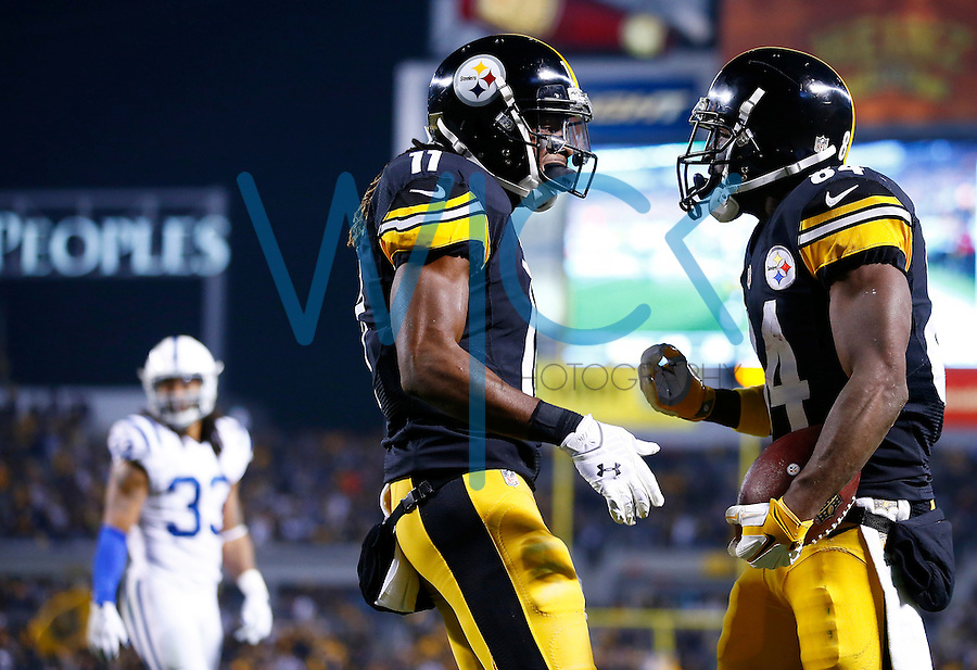Antonio Brown #84 celebrates with teammate Markus Wheaton #11 of the Pittsburgh Steelers following his touchdown in the first half against the Indianapolis Colts during the game at Heinz Field on December 6, 2015 in Pittsburgh, Pennsylvania. (Photo by Jared Wickerham/DKPittsburghSports)