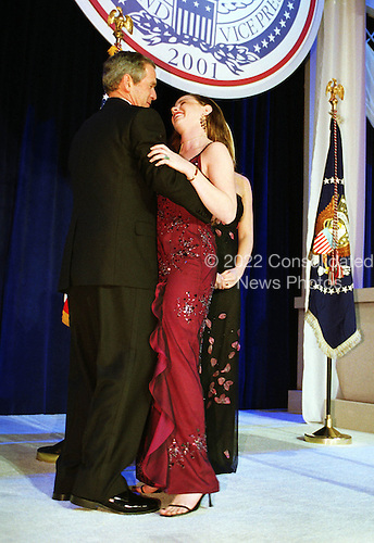 United States President George W. Bush dances with his daughter Barbara at one of nine inaugural balls in Washington, D.C. on January 20, 2001..Credit: Robert Trippett / Pool via CNP.