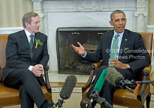 United States President Barack Obama, right, makes remarks to the press as he meets Prime Minister Enda Kenny of Ireland in the Oval Office of the White House in Washington, D.C. on Friday, March 14, 2014.<br /> Credit: Ron Sachs / Pool via CNP