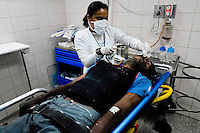 A Venezuelan physician attends a narcotic overdosed patient in the state hospital in Caracas, Venezuela, 25 June 2006.