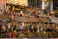 India, Uttar Pradesh, Varanasi, Ganges River, ghats &amp; early morning bathers.<br />
