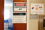 Safety signs and information outside a lab at Auburn University's Poultry Science Building in Auburn, Alabama November 18, 2009