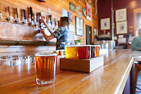 Bartender Cameron Davis pouring beer at Waltz Brewing pub in Forest Grove, Oregon