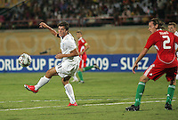 Italy's Gianvito Misuraca (11) chases the ball against Hungary's Janos Szabo (2) the match against Italy during the FIFA Under 20 World Cup Quarter-final match at the Mubarak Stadium  in Suez, Egypt, on October 09, 2009. Hungary won 2-3 in overtime.