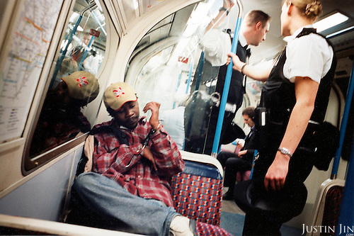 A metro passenger is arrested after riding with a child's ticket in London's Finsbury Park and then lying about his age. .Picture taken 2004 by Justin Jin