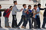 Boys line up as they enter school in the Zaatari Refugee Camp, located near Mafraq, Jordan. Opened in July, 2012, the camp holds upwards of 50,000 refugees from the civil war inside Syria. International Orthodox Christian Charities and other members of the ACT Alliance are active in the camp providing essential items and services.