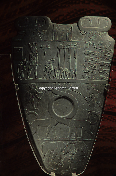 Egypt of the Pharaohs, Narmer Palette, mythical beasts symbolize unification of Upper and Lower Egypt, Narmer depicted wearing Red Crown, Predynastic, Egypt, Egyptiam Museum, Cairo