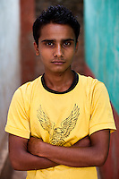 Dhundi Raj Tiwari, 20, a Village Child Protection Committee (VCPC) member poses for a portrait at the information center they built in Lekhapharsa vilage, Surkhet district, Western Nepal, on 30th June 2012. Dhundi with the VCPC works to intervene in child marriages such as the case of Pramila and is supported by Save the Children and local NGO Safer Societies. In Surkhet, StC partners with Safer Society, a local NGO which advocates for child rights and against child marriage. Photo by Suzanne Lee for Save The Children UK