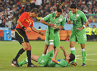 Algeria's Anther Yahia fights off cramps in the final minutes of the match. The United States won Group C of the 2010 FIFA World Cup in dramatic fashion, 1-0, over Algeria in Pretoria's Loftus Versfeld Stadium, Wednesday, June 23rd..