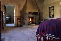 The stone fireplace is the only source of heating in this guest
