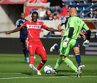 Chicago forward Patrick Nyarko (14) blocks an attempted clearance by New England goalkeeper Matt Reis (1).  Nyarko would score on the play.  The Chicago Fire defeated the New England Revolution 3-2 at Toyota Park in Bridgeview, IL on Sept. 25, 2011.