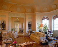 Elaborate plaster mouldings and bas reliefs decorate the walls and ceiling of this formal drawing room