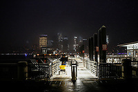 The lower Manhattan and the World Trade Center are seen while a man clean the path of snow at the ferry station in Exchange Place in New Jersey, 01/17/2016 Photo by VIEWpress