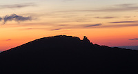 "Sunset over Queribus Castle or Chateau de Queribus, Cathar Castle, Cucugnan, Corbieres, Aude, France.  This castle, built from 13th to 16th centuries, is considered the last Cathar stronghold. It sits on a high peak at 728m. It is one of the ""Five Sons of Carcassonne"" or ""Cinq Fils de Carcassonne"". It is a listed monument historique and has been fully restored, restoration work being completed in 2002. The castle and hill are here silhouetted against the sunset. Picture by Manuel Cohen"