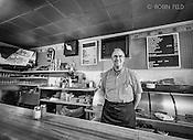 Falbs Restaurant, Dayton Ohio. Black and white of man behind counter.
