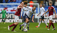 Bolton Wanderers' Darren Pratley battles with Northampton Town's John-Joe O'Toole<br /> <br /> Photographer Alex Dodd/CameraSport<br /> <br /> The EFL Sky Bet League One - Bolton Wanderers v Northampton Town - Saturday 18th March 2017 - Macron Stadium - Bolton<br /> <br /> World Copyright &copy; 2017 CameraSport. All rights reserved. 43 Linden Ave. Countesthorpe. Leicester. England. LE8 5PG - Tel: +44 (0) 116 277 4147 - admin@camerasport.com - www.camerasport.com