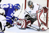 AMERICAN HOCKEY LEAGUE -- Toronto player Bates Battaglia (33) takes a shot on Rampage goalie Josh Tordjman (29) during game four of the first round Calder Cup playoff series between the Toronto Marlies and the San Antonio Rampage, April 23, 2008, at the AT&T Center in San Antonio, Texas. Toronto won 3 - 2 to even the series at 2 - 2. (Darren Abate/PressPhotoIntl.com)