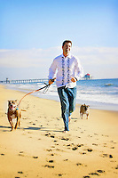 27 November 2010:  Steve Puente with his two doggies Honey and Daisy at the beach.