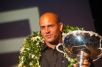 Gold Coast, Queensland, February 25th 2006.Kelly Slater  (USA) recieving his 7th World Title trophy at the ASP WORLD CHAMPIONS AWARDS BANQUET held at the Gold Coast Convention Centre, QUEENSLAND, AUSTRALIA . Photo: Joli