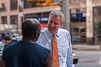 "New York Mayoral candidate and Public Advocate Bill DeBlasio does a ""meet and greet"" campaign event in front of the newly opened Fairway supermarket in the Chelsea neighborhood of New York on Tuesday, July 30, 2013. In the seemingly never ending battle for City Hall DeBlasio has been placed as number two behind Christine Quinn in recent polls.  (© Richard B. Levine)"