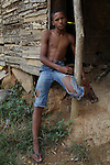 Marcelino Gálvez Suárez, 17, from La Cerca, sits outside his home. Barrick and Goldcorp's Pueblo Viejo open-pit gold mine threatens the cocoa-bean producing community of La Cerca. Cotuí, Sánchez Ramírez, Dominican Republic. April 2012.
