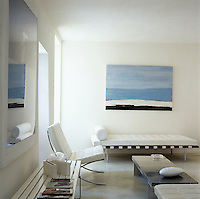 This contemporary white sitting room is furnished with pieces by Mies van der Rohe